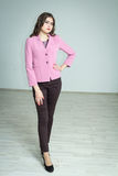 Girl in a pink jacket. Portrait of a girl in a pink jacket and pants delicious Stock Image