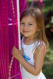 Girl with pink lighting tubes Royalty Free Stock Photography