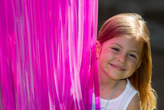 Girl with pink lighting tubes Royalty Free Stock Photos