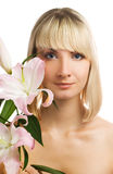 Girl with pink lily Stock Photos