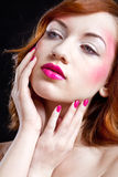 Girl with pink makeup. Closeup of a girls face - pink lips and nails Stock Image