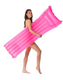 Girl with pink mattress Stock Photography