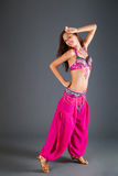 Girl in Pink Orient Dance Costume Shows Hand Position Stock Photography