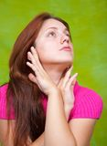 Girl in pink over green Stock Photos