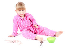 Girl in pink pajamas Stock Images