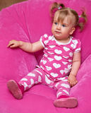 Girl in pink pajamas. Young girl in pink pajamas with hearts Royalty Free Stock Photo