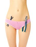 Girl in pink panties with screw key and pliers Royalty Free Stock Image