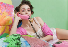 Girl with pink phone Royalty Free Stock Image