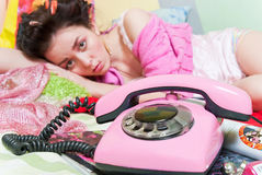 Girl with pink phone Stock Image
