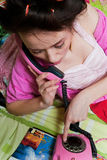 Girl with pink phone Royalty Free Stock Photo