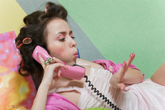 Girl with pink phone Royalty Free Stock Photography