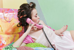 Girl with pink phone Stock Images