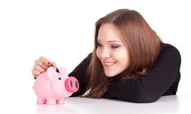 Girl with pink piggy bank Stock Photo