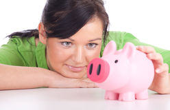 Girl with pink piggy bank Stock Images