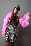 Girl pink plume and black feather on head. Carnival. Stock Image