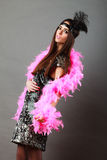 Girl pink plume and black feather on head. Carnival. Stock Images