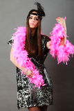 Girl pink plume and black feather on head. Carnival. Royalty Free Stock Photo