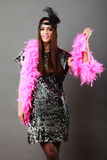 Girl pink plume and black feather on head. Carnival. Royalty Free Stock Photos