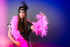 Girl pink plume and black feather on head. Carnival. Royalty Free Stock Photography