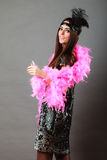 Girl pink plume and black feather on head. Carnival. Royalty Free Stock Image