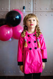 The girl in a pink raincoat Royalty Free Stock Photo