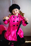 The girl in a pink raincoat Stock Photo