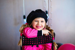 The girl in a pink raincoat Royalty Free Stock Photography