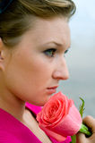 Girl with pink rose Royalty Free Stock Photos