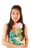 Girl with pink rose. Stock Photography