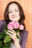 Girl and pink roses Stock Image