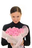 Girl and pink roses. Girl with a bouquet of pink roses Stock Image