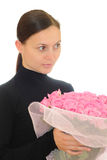 Girl and pink roses. Girl with a bouquet of pink roses Royalty Free Stock Images