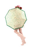 Girl in pink rubber boots with hat and cute green umbrella with hearts. Stock Photography