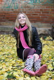 The girl in the pink scarf and boots Stock Photography