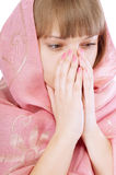 Girl in pink scarf prays Royalty Free Stock Image