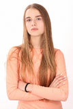Girl in pink shirt. Close up. White background Royalty Free Stock Photo