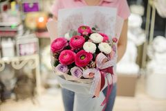 Girl holding a beautiful bouquet of violet, white and pink tender flowers Stock Photos
