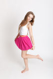 Girl in a pink skirt Royalty Free Stock Image
