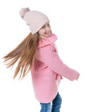 Girl in pink spinning and dancing, isolated Royalty Free Stock Photos