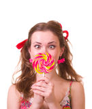 Girl with pink spiral lollipops Stock Image