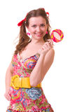 Girl with pink spiral lollipops royalty free stock photo