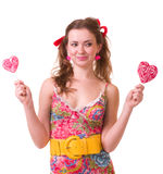 Girl with pink spiral lollipops Stock Photo