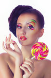 Girl with pink spiral lollipops Stock Images