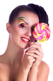 Girl with pink spiral lollipops Royalty Free Stock Photography