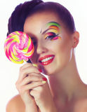 Girl with pink spiral lollipops Stock Photos