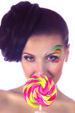 Girl with pink spiral lollipops Stock Photography