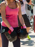 Girl in Pink Sportswear doing Fitness with Punching Mitts in Out Stock Image