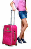 Girl with a pink suitcase Stock Photography