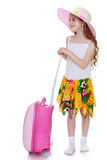 The girl with the pink suitcase Stock Images