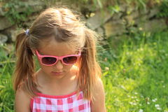 Girl in pink sun glasses Stock Photo